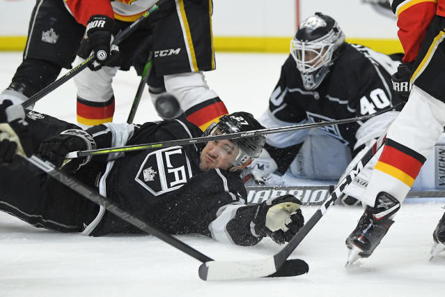 Los Angeles Kings defenseman Alec Martinez, left, helps goaltender Calvin Petersen defend the goal during the third period of the team's NHL hockey game against the Calgary Flames on Wednesday, Feb. 12, 2020, in Los Angeles. The Kings won 5-3. (AP Photo/Mark J. Terrill)