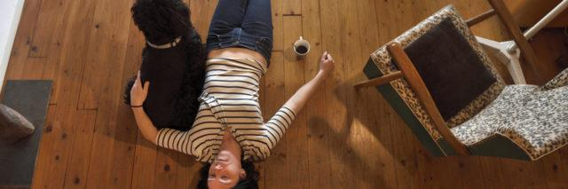 Woman lying on the floor of her house.