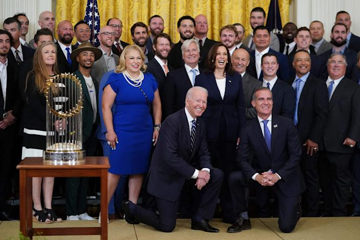 US President Joe Biden and Vice President Kamala Harris pose with the Los Angeles Dodgers team as they welcome the 2020 World Series Champions during a ceremony in the East Room of the White House in Washington, DC on July 2, 2021. (Photo by MANDEL NGAN / AFP)