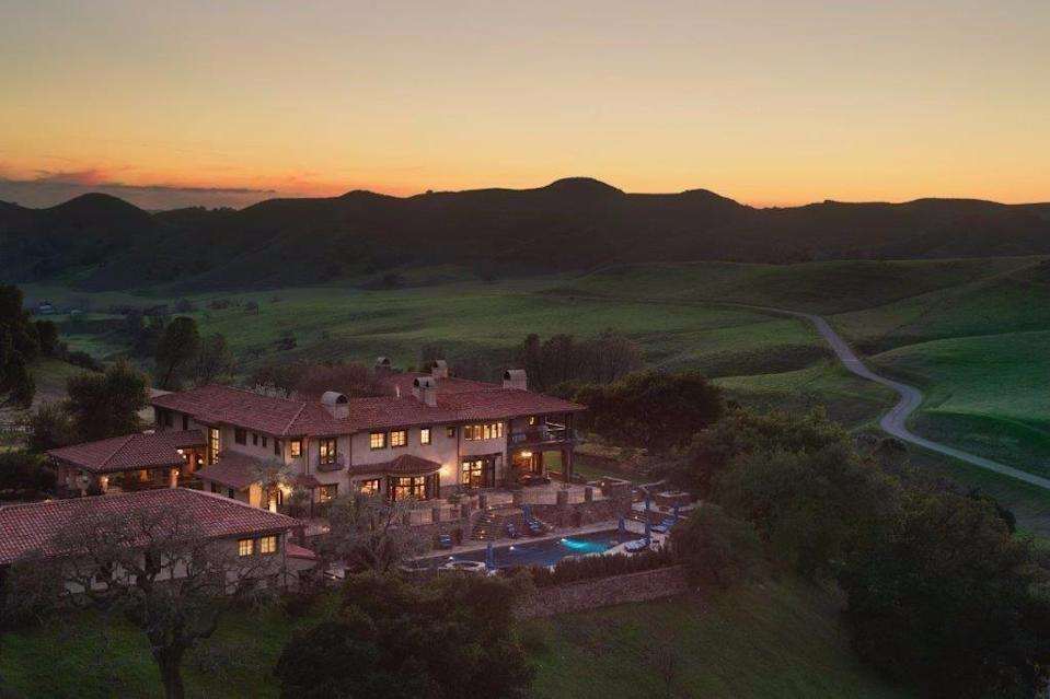 """<p>Encapsulating all that is great about the Golden State, this six-bedroom Californian ranch is ideal for those looking to escape the crowds. Tucked away deep in 4,600 acres of gorgeous rolling hills, the <a href=""""https://www.housebeautiful.com/uk/lifestyle/property/"""" rel=""""nofollow noopener"""" target=""""_blank"""" data-ylk=""""slk:property"""" class=""""link rapid-noclick-resp"""">property</a> has its own helicopter pad, tennis court, swimming pool, and gym. </p><p><a href=""""https://www.rightmove.co.uk/properties/69313757"""" rel=""""nofollow noopener"""" target=""""_blank"""" data-ylk=""""slk:This property is currently on the market for £28,825,996 with American Farm & Ranch via Rightmove."""" class=""""link rapid-noclick-resp"""">This property is currently on the market for £28,825,996 with American Farm & Ranch via Rightmove.</a><br></p>"""