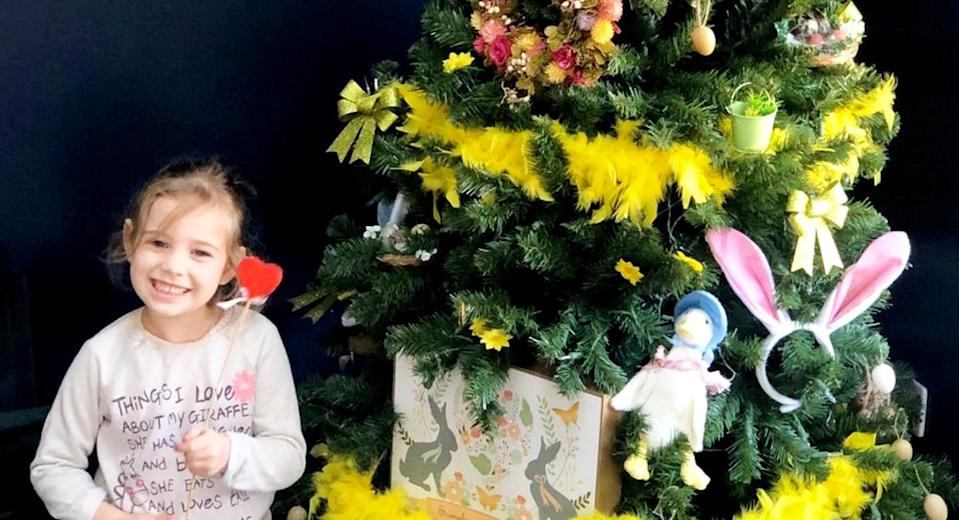 Children are decorating Christmas trees in their homes with Easter decorations amid the coronavirus lockdown (SWNS)