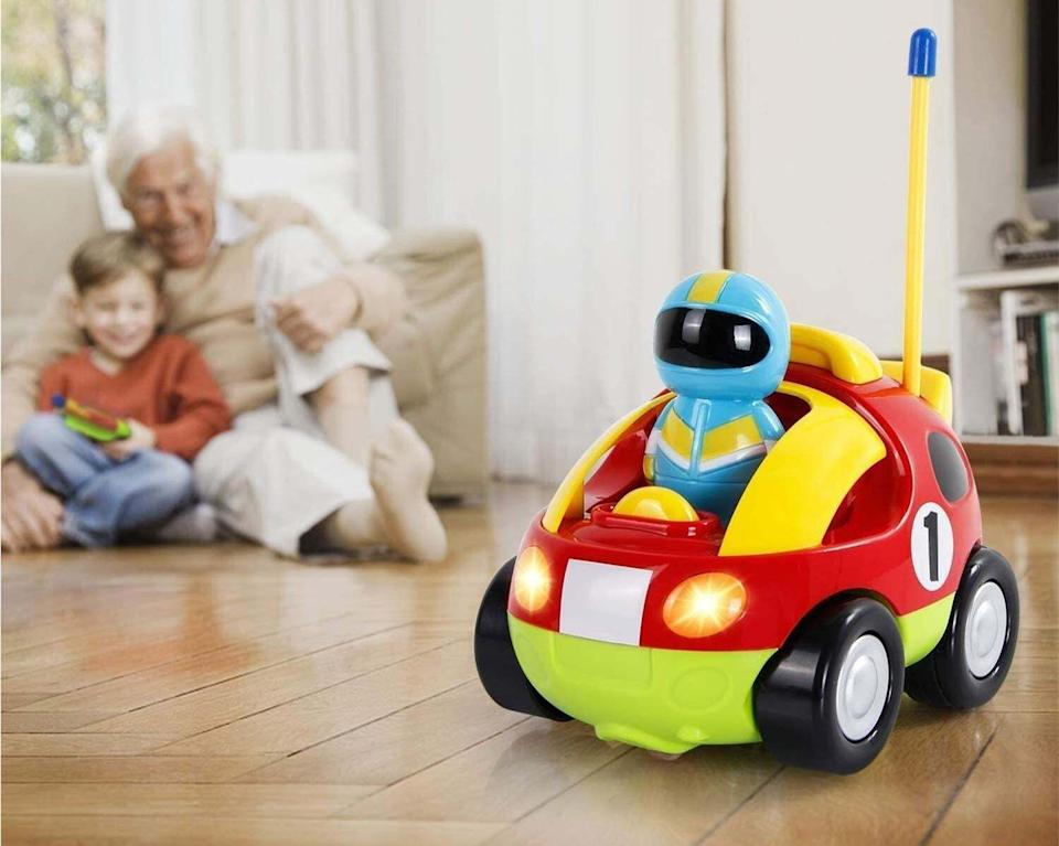 """Not only do the horn and headlights function on the car, but there are alsothree removable driver figures for toddlers to get their first taste of simplified RC-fun with forward and reverse left functions.<br /><br /><strong>Promising review:</strong>""""This car is so easy to work as there are only two buttons. My one-year-old has figured it out and giggles while it soars backward in circles. It's surprisingly off-road-able!<strong>It can climb over light blankets and other thin things on the ground. This requires batteries so don't forget them!</strong>The bright colors are fun and the music/lights are wonderful. It's a little on the loud side, but bearable. The race car driver makes noise when you click him into place and this makes my son laugh."""" —<a href=""""https://amzn.to/3vdgN5O"""" target=""""_blank"""" rel=""""noopener noreferrer"""">Kenneth S. Foord</a><br /><strong><br />Get it from Amazon for<a href=""""https://amzn.to/3dInZB6"""" target=""""_blank"""" rel=""""noopener noreferrer"""">$15.94</a>.</strong>"""