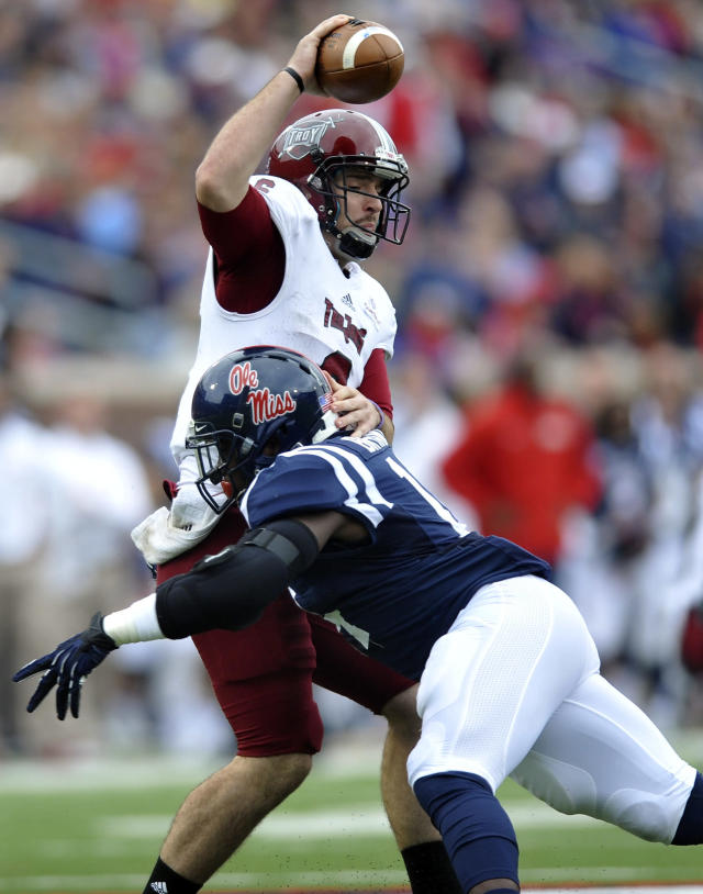Mississippi linebacker Serderius Bryant (14) sacks Troy quarterback Corey Robinson (6) during an NCAA college football game in Oxford, Miss., Saturday, Nov. 16, 2013. (AP Photo/Oxford Eagle, Bruce Newman)
