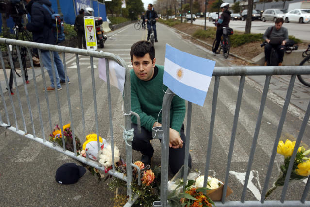 <p>George Embiricos, age 27, leaves flowers at the bike path along West Street in Manhattan in commemoration of those who died in the attack on Oct. 31, 2017 in New York City. (Photo: Carolyn Cole/Los Angeles Times via Getty Images </p>
