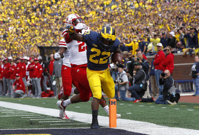 Michigan running back Karan Higdon (22) scores on a 44-yard run as Nebraska defensive back Antonio Reed (25) defends in the first half of an NCAA football game in Ann Arbor, Mich., Saturday, Sept. 22, 2018. (AP Photo/Paul Sancya)