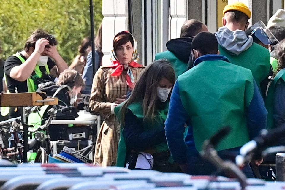 US singer, songwriter and actress Lady Gaga (C) is pictured on March 10, 2021 in central Milan on the set of the new Ridley Scott movie about the Gucci