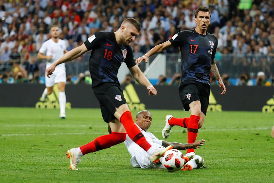 <p>Last-ditch defending: Ashley Young gets his toe to the ball to prevent Ante Rebic shooting in a dangerous position </p>