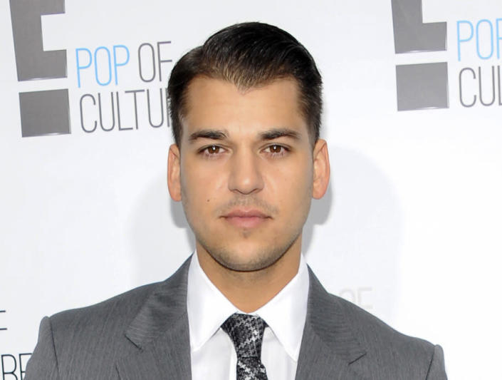 """FILE - In this April 30, 2012 file photo, Rob Kardashian from the show """"Keeping Up With The Kardashians"""" attends an E! Network upfront event in New York. Rob and former fiancee Blac Chyna had a difficult relationship, leading him to post revenge porn on Instagram that got him banned from the platform. (AP Photo/Evan Agostini, File)"""