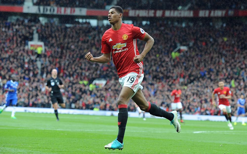 Manchester United's Marcus Rashford celebrates after scoring his side's first goal - Credit: AP