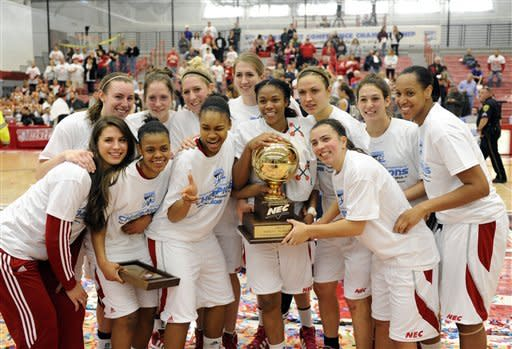 Sacred Heart's players celebrate with the trophy after their 58-48 victory over Monmouth in the NEC championship final women's basketball game in Fairfield, Conn., Sunday, March 11, 2012. (AP Photo/Fred Beckham)