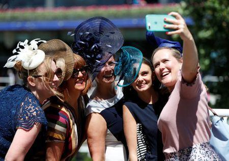 Horse Racing - Royal Ascot - Ascot Racecourse, Ascot, Britain - June 21, 2018 Racegoers take a selfie before the start of the racing Action Images via Reuters/Paul Childs