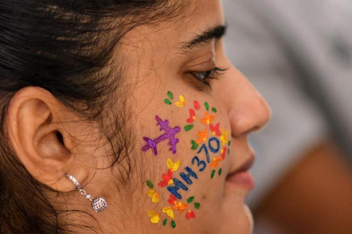 """Relatives of passengers of MH370 urged the Malaysian government to undertake a """"comprehensive review"""" of all matters related to the plane's disappearance (AFP Photo/Manan VATSYAYANA)"""