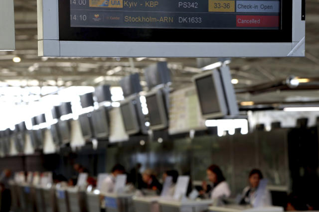 A flights screen showing a cancelled flight of Thomas Cook at Larnaca airport in the eastern Mediterranean island of Cyprus, Monday, Sept. 23, 2019. The collapse of Thomas Cook will strike a major blow to the Cypriot tourism industry. (AP Photo/Petros Karadjias)