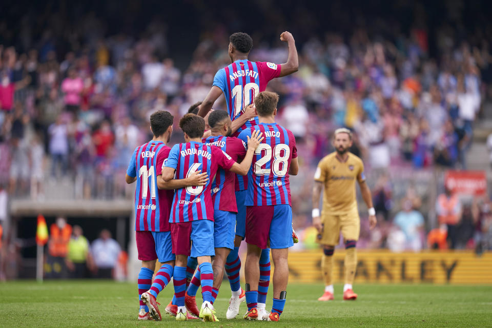 BARCELONA, SPAIN - SEPTEMBER 26: Ansu Fati of FC Barcelona celebrates with team mates after scoring his team's third goal during the LaLiga Santander match between FC Barcelona and Levante UD at Camp Nou on September 26, 2021 in Barcelona, Spain. (Photo by Pedro Salado/Quality Sport Images/Getty Images)