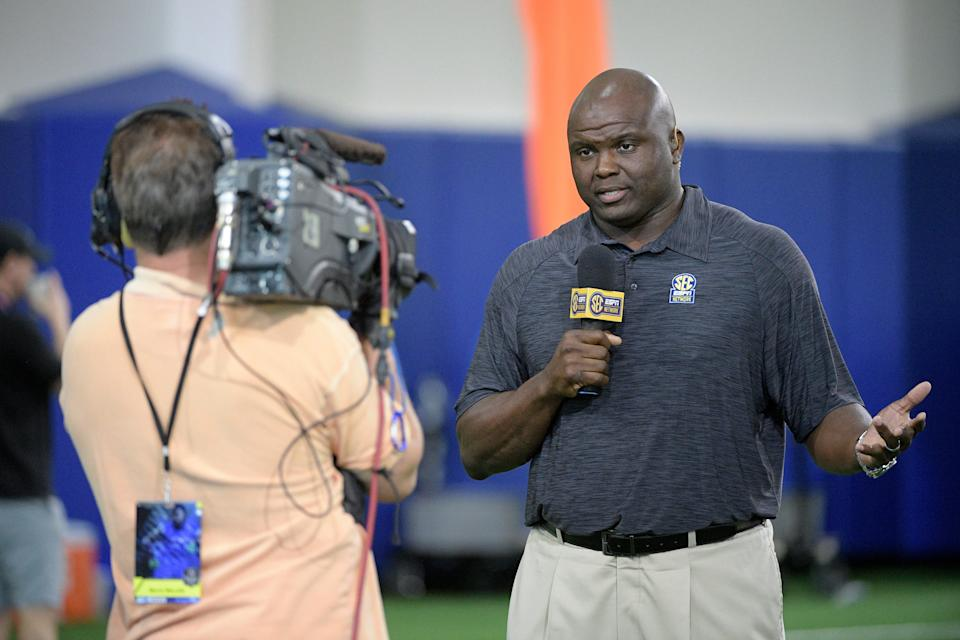 In this March 28, 2017, file photo, SEC Network analyst Booger McFarland, right, broadcasts during Florida's NFL Pro Day in Gainesville, Fla.