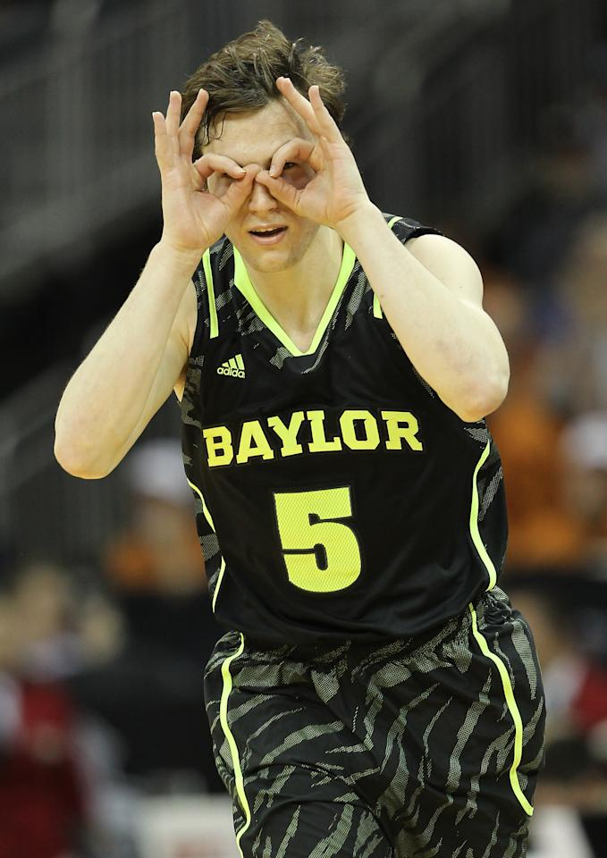KANSAS CITY, MO - MARCH 09:  Brady Heslip #5 of the Baylor Bears celebrates a three pointer in the second half against the Kansas Jayhawks during the semifinals of the 2012 Big 12 Men's Basketball Tournament at Sprint Center on March 9, 2012 in Kansas City, Missouri.  (Photo by Jamie Squire/Getty Images)