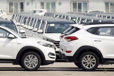 FILE PHOTO: Cars made by Hyundai Motor Co are parked in the compound of the South Korean automaker's plant in Beijing, China, August 30, 2017. REUTERS/Thomas Peter/File Photo