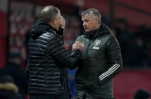 Ole Gunnar Solskjaer, right, shakes hands with Sheffield United manager Chris Wilder