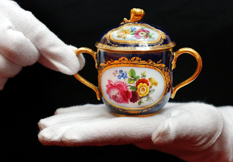 <strong>One of a pair of Meissen chocolate pots, circa 1870, given to the then Princess Elizabeth and Prince Philip by Pope Pius XII as a gift for their wedding on 20 November 1947</strong> (PA Archive/PA Images)