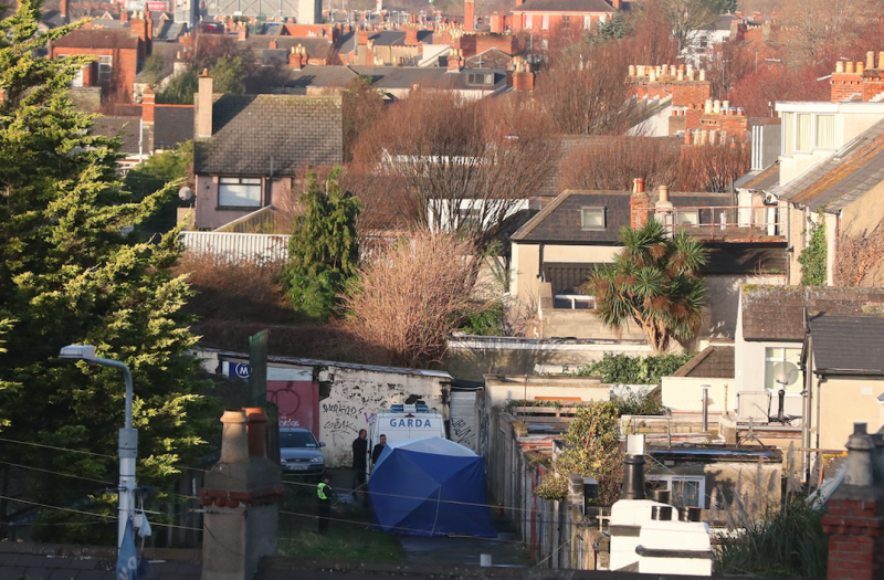 Garda at the scene on Trinity Terrace in the Drumcondra area of Dublin (PA)