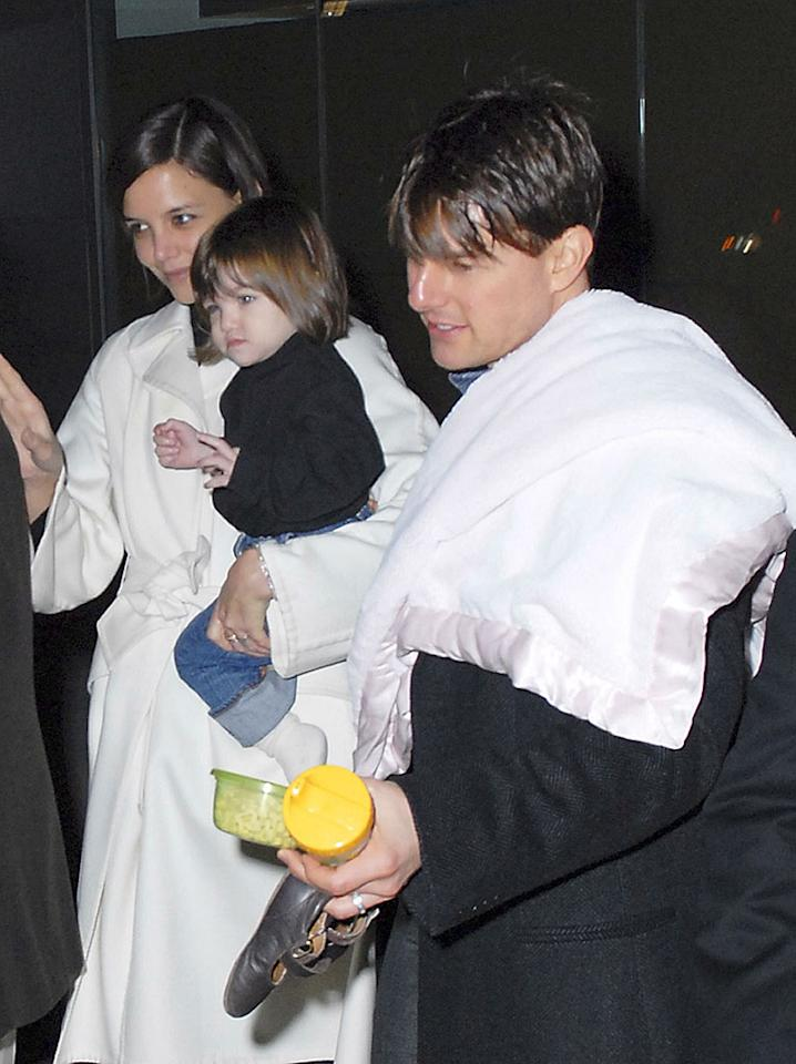 """Tom Cruise, wife Katie Holmes, and daughter Suri were in Washington D.C. to promote """"Lions for Lambs."""" Instead of leading man, it looks like Tom played Mr. Mom that night. Drummond/Young/<a href=""""http://www.splashnewsonline.com"""" target=""""new"""">Splash News</a> - November 7, 2007"""