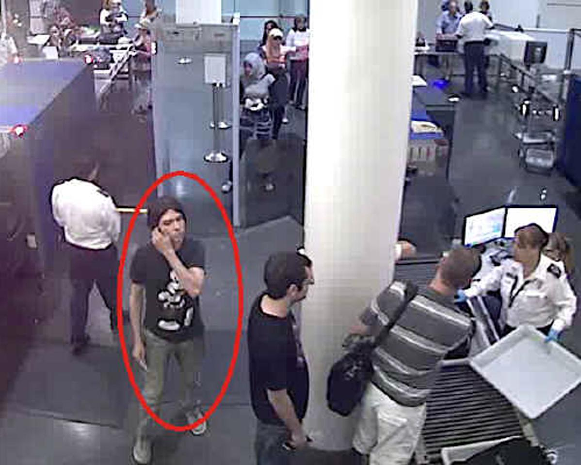 This surveillance image provided by Interpol shows who authorities believe is Luka Rocco Magnotta at a security checkpoint area. A state prosecutor says police are investigating two claimed French capital sightings of the Canadian porn actor wanted in connection with a gruesome murder in Montreal. (AP Photo/Interpol)
