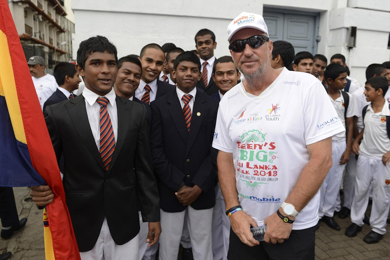 KANDY, SRI LANKA - NOVEMBER 4 In this handout image provided by Laureus, Sir Ian Botham with students from Trinity College before the fourth day of Beefy's Big Sri Lanka walk 2013 walk from Kandy to Pinawella on November 4, 2013 in Sri Lanka. (Photo by Philip Brown/Laureus via Getty Images)