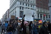 <p>A woman holds up a sign during a march in New York, Jan. 29, 2017, protesting President Donald Trump's immigration order. (Gordon Donovan/Yahoo News) </p>