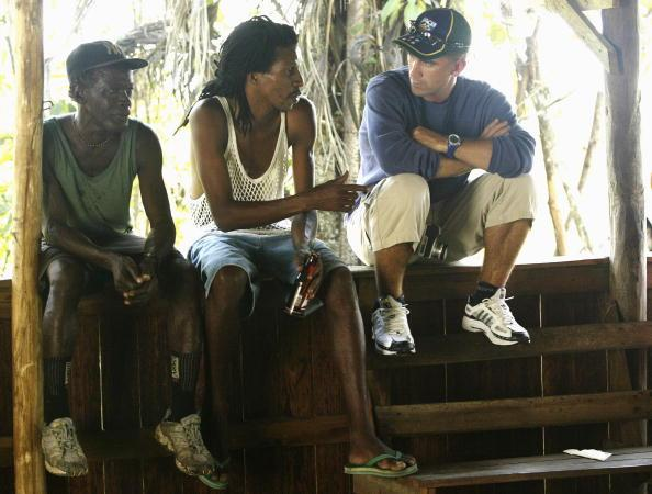 GEORGETOWN - APRIL 9:  Justin Langer of Australia chats with some locals at Kaieteur Falls during a team trip to Kaieteur and Orinduik Falls in Guyana on April 9, 2003. (Photo by Hamish Blair/Getty Images)