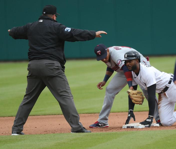Detroit Tigers shortstop Niko Goodrum (28) slides safely into second ahead of the tag by Minnesota Twins shortstop Jorge Polanco (11) during fourth inning action Saturday, May 8, 2021 at Comerica Park in Detroit.