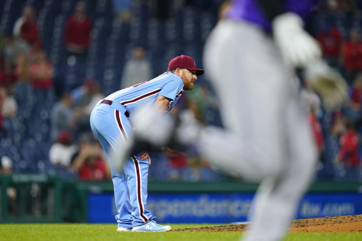Philadelphia Phillies pitcher Ian Kennedy, left, reacts after giving up a two-run home run to Colorado Rockies' Ryan McMahon during the ninth inning of a baseball game, Thursday, Sept. 9, 2021, in Philadelphia. (AP Photo/Matt Slocum)