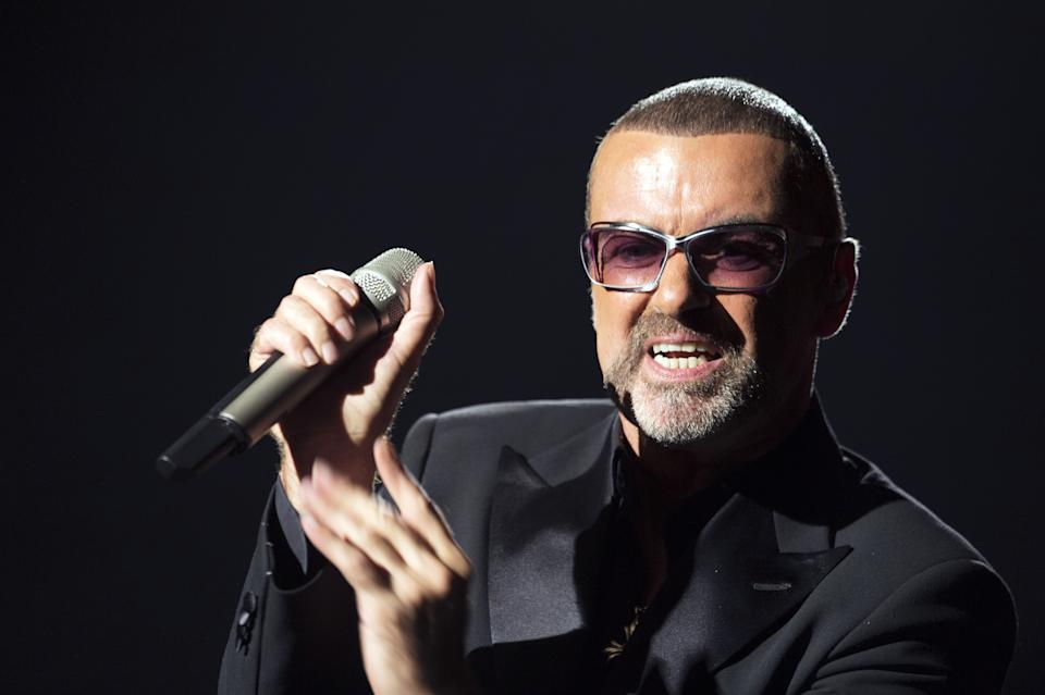 George Michael performs on stage during a charity gala for the benefit of Sidaction, at the Opera Garnier in Paris. (MIGUEL MEDINA/AFP/Getty Images)