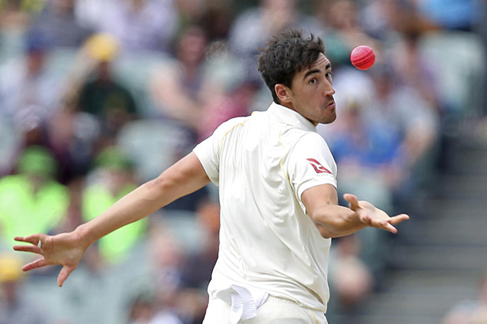 FILE - In this Dec. 4, 2017, file photo, Australia's Mitchell Starc reaches out to take the wicket of England's Jonny Bairstow, caught and bowled for 21 runs, during their Ashes cricket test match in Adelaide, Australia. Starc hasn't picked up a cricket bat or ball in two months, and isn't exactly salivating at the prospect of going back to work. (AP Photo/Rick Rycroft, File)