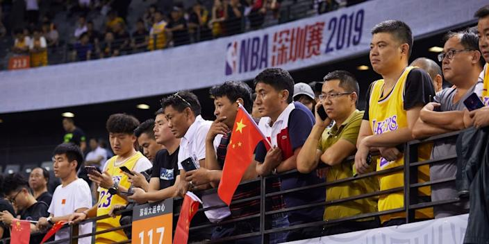 Fans watching the Los Angeles Lakers-Brooklyn Nets preseason game in Shanghai, China.