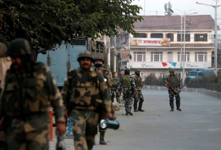 Indian security force personnel patrol near the residence of Syed Ali Shah Geelani after his death in Srinagar