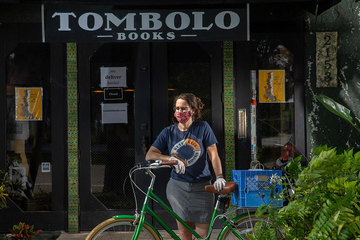 Alsace Walentine's bookstore pivoted to online orders. She mails them to out-of-town customers and delivers them herself via bicycle to local customers. Chris Zuppa/The Penny Hoarder