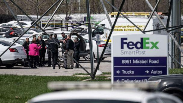 PHOTO: A group of crime scene investigators gather to speak in the parking lot of a FedEx SmartPost on April 16, 2021, in Indianapolis. (Jon Cherry/Getty Images)