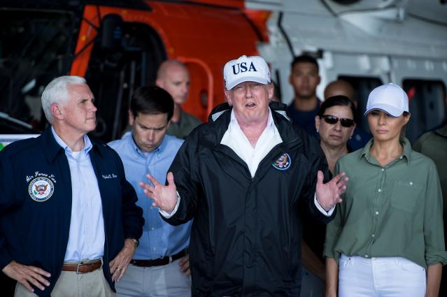 People on social media think President Trump forgot Melania was standing beside him during a press conference on Hurricane Irma in September 2017. (Photo: Getty Images)
