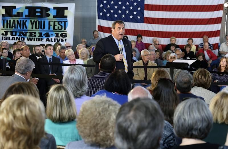 "New Jersey Gov. Chris Christie answers a question Tuesday, April 30, 2013, in Long Beach Township, N.J., during a town hall meeting. The Republican governor says he soon will ""call out"" stubborn homeowners by name if they continue to refuse to sign easements permitting a beach replenishment project with dunes. (AP Photo/Mel Evans)"