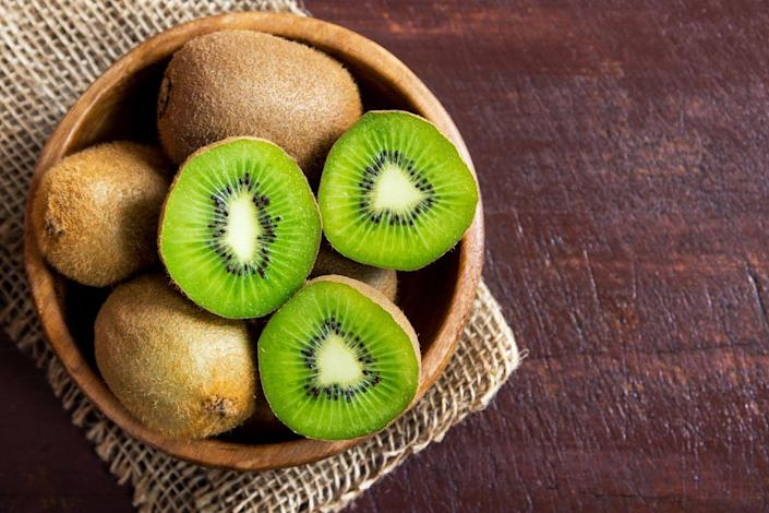 """<p>Kiwis have a lot of fiber and fluid, but they also contain an enzyme called actinidain that helps with the digestive process, Cording says. """"Kiwi can be a really gentle way to stimulate the digestive process,"""" she adds.</p>"""