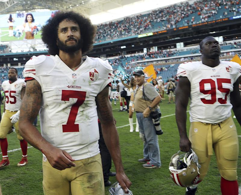 Colin Kaepernick, leaving the field after a loss in Miami last season, is still looking for work in the NFL. (AP)