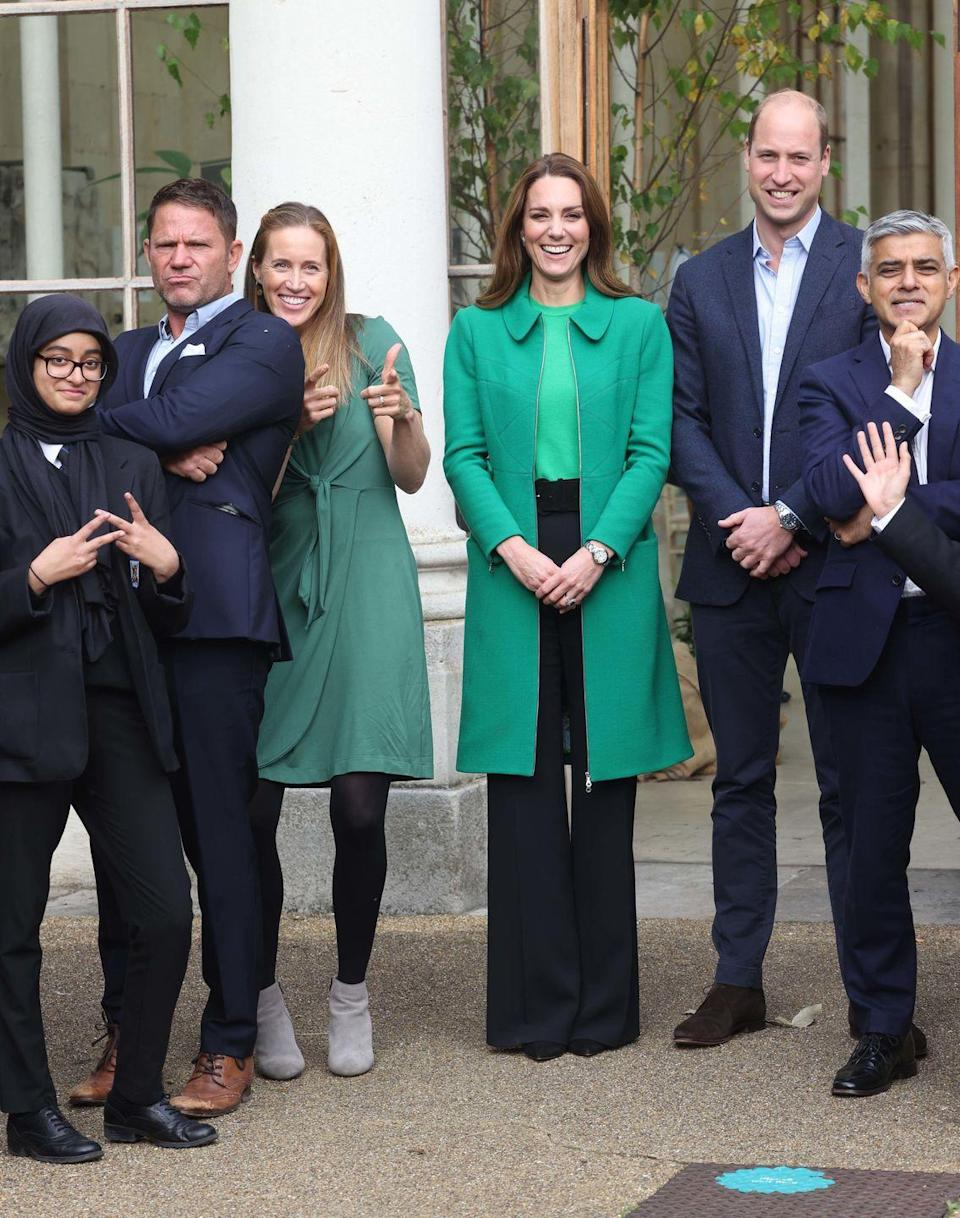 """<p>The Duchess, always on theme, chose a Kelly green coat and sweater to attend a <a href=""""https://www.townandcountrymag.com/society/tradition/a37948170/kate-middleton-green-coat-prince-william-generation-earthshot-photos/"""" rel=""""nofollow noopener"""" target=""""_blank"""" data-ylk=""""slk:Generation Earthshot event"""" class=""""link rapid-noclick-resp"""">Generation Earthshot event</a>, encouraging students to think about ideas for repairing the planet. She paired the green items with black, wide leg trousers. </p>"""