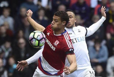 Britain Football Soccer - Swansea City v Middlesbrough - Premier League - Liberty Stadium - 2/4/17 Middlesbrough's Rudy Gestede in action with Swansea City's Martin Olsson  Reuters / Rebecca Naden Livepic