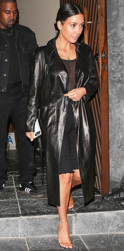 <p>The star paired a set of knee-length frayed-hem shorts with a sheer top, worn under a shin-grazing leather coat as she stepped out for dinner at a sushi restaurant in Brentwood, Calif., with Kanye West. Clear ankle-strap heels completed her ensemble.</p>