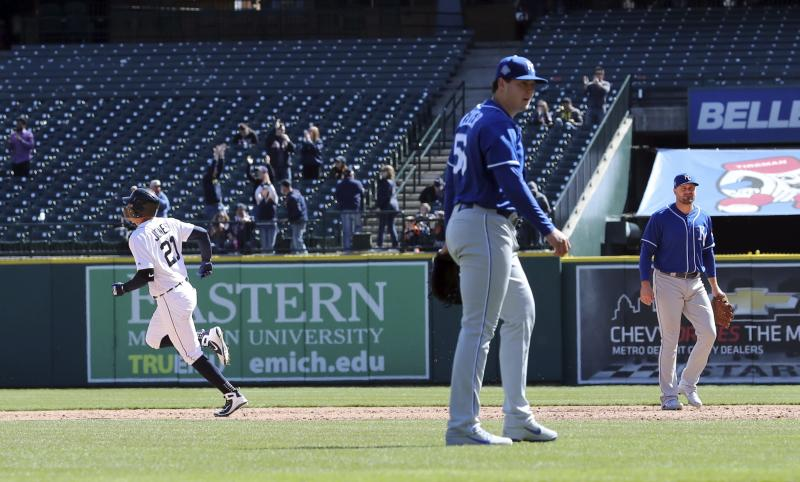 Kansas City Royals relief pitcher Brad Keller, foreground, walks to the dugout as Detroit Tigers' JaCoby Jones, left, rounds the bases for a walkoff solo home run during the 10th inning of the first game of a baseball doubleheader, Friday, April 20, 2018, in Detroit. (AP Photo/Carlos Osorio)