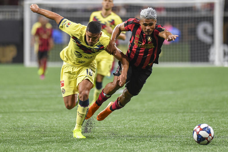 Aug 14, 2019; Atlanta, GA, USA; Club America defender Bruno Valdez (18) and Atlanta United forward Josef Martinez (7) battle for the ball during the second half at Mercedes-Benz Stadium. Mandatory Credit: Dale Zanine-USA TODAY Sports