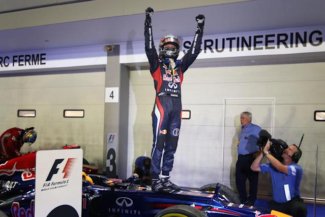 SINGAPORE - SEPTEMBER 23: Sebastian Vettel of Germany and Red Bull Racing celebrates in parc ferme after winning the Singapore Formula One Grand Prix at the Marina Bay Street Circuit on September 23, 2012 in Singapore, Singapore. (Photo by Clive Mason/Getty Images)