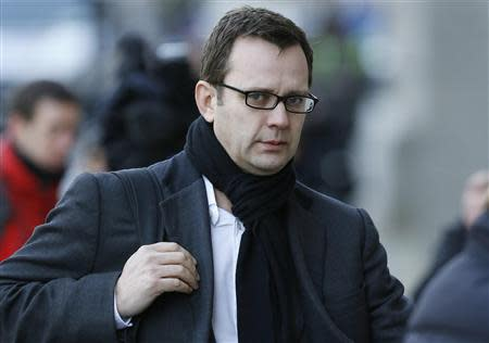 Former News of the World editor Andy Coulson arrives at the Old Bailey courthouse in London January 27, 2014. REUTERS/Suzanne Plunkett