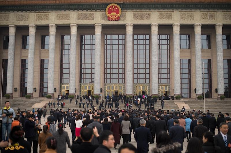 The ruber-stamp parliament is being held at the the Great Hall of the People in Beijing (AFP Photo/NICOLAS ASFOURI)