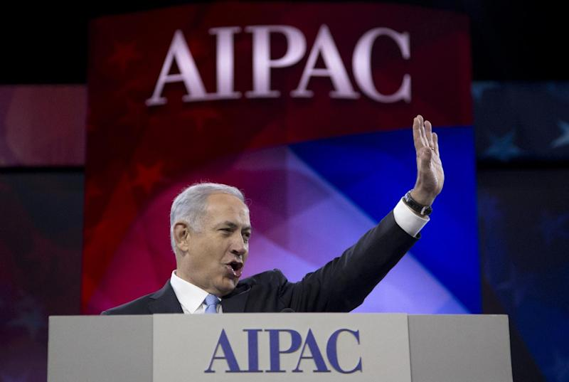 Israeli Prime Minister Benjamin Netanyahu waves to the cheering audience as he arrives to speak to the AIPAC meeting at the Washington Convention Center, Tuesday, March 4, 2014, in Washington. On Monday, the prime minister met with President Barack Obama at the White House. (AP Photo/Carolyn Kaster)